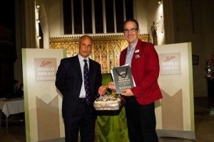 Chris Newenham of Tiptree presents Peter Cook with his trophy and prize as the Tiptree World Bread Awards 2014 champion