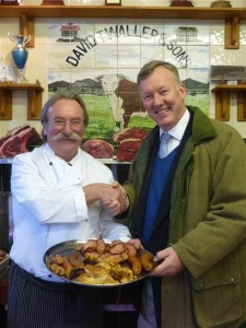 Dave Waller and Bill Wiggin MP admire a salver of local breakfast produce