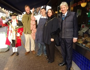 Bill the Bell and guests salute the winning sausage